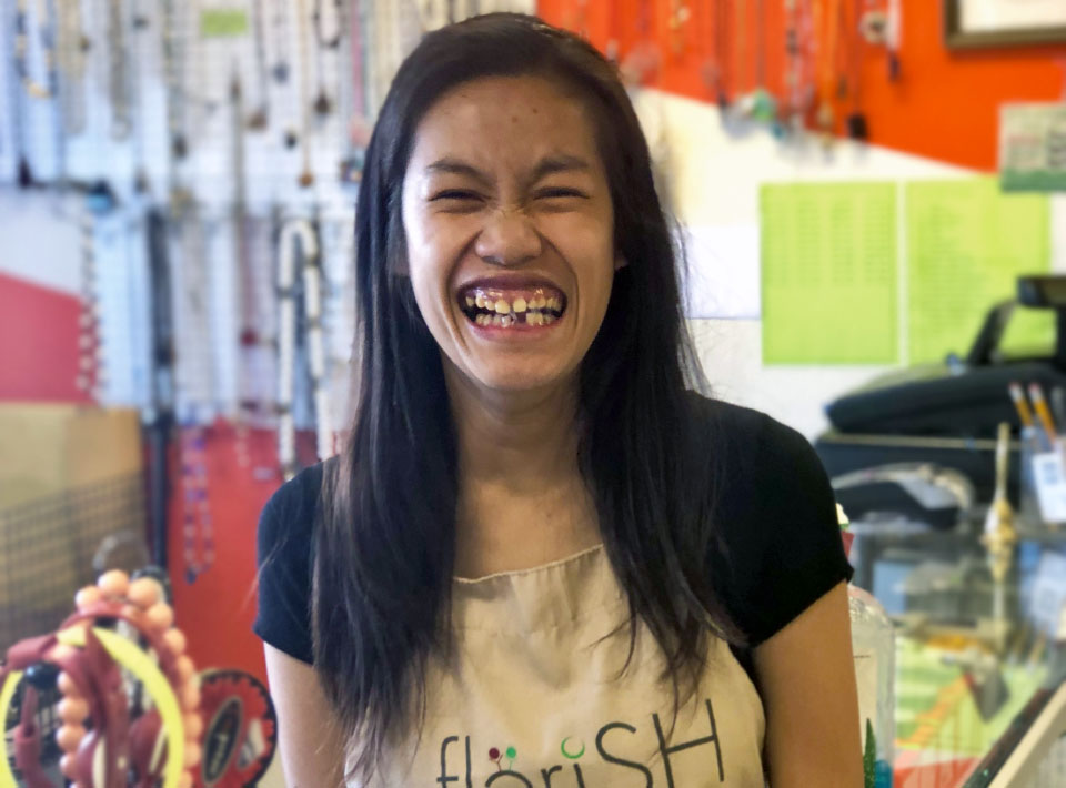 A woman smiling while in the Flerish store