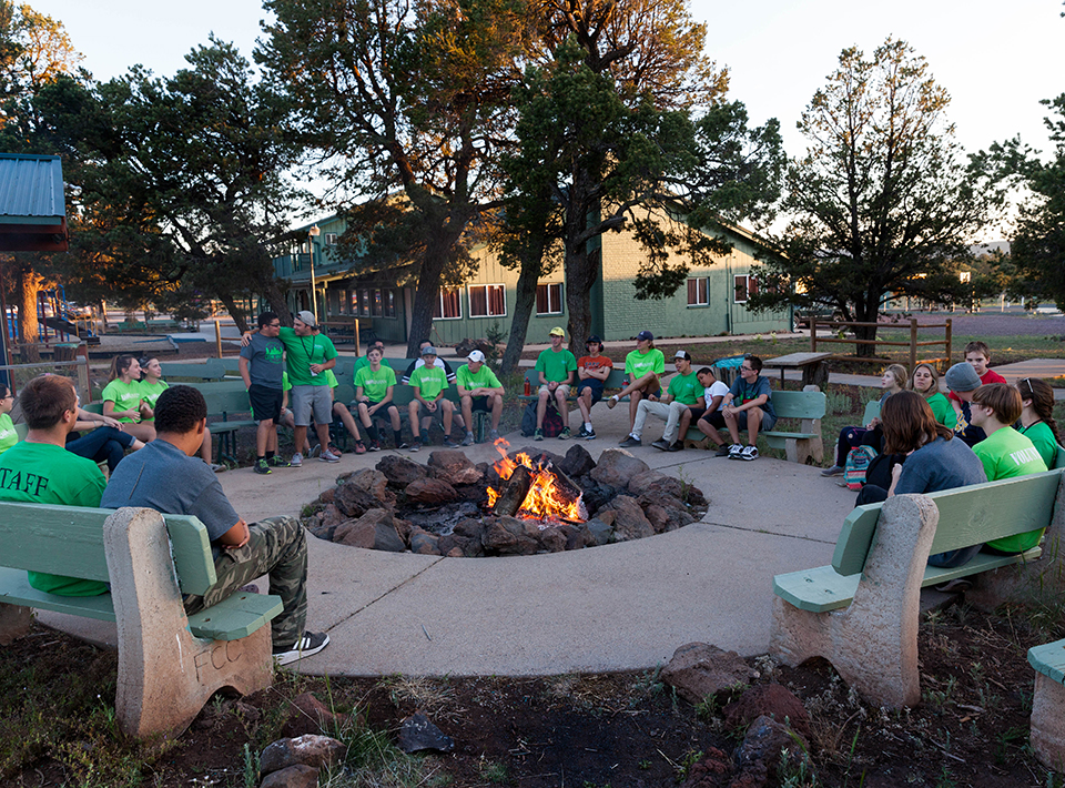 Camp Civitan staff and campers enjoy time around the outdoors fire pit.