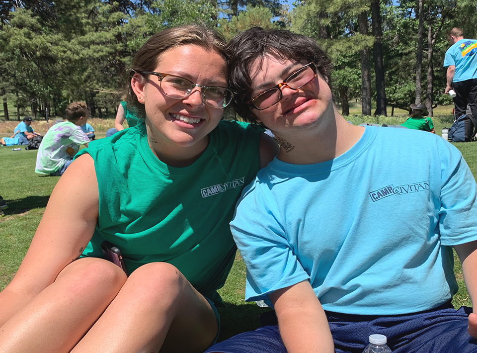 Camp Civitan staff member with camper