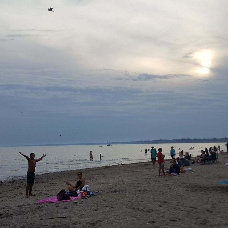Lake Erie at dusk with people enjoying the sunset